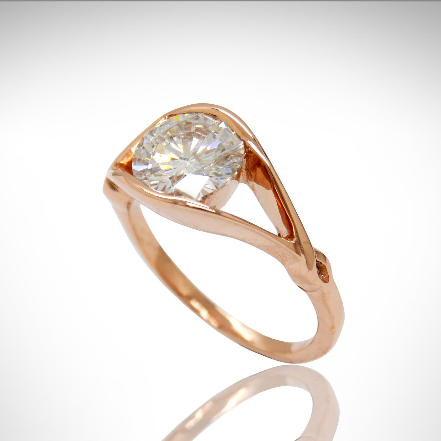 14k Rose gold diamond ring with split shank and twist detail.