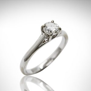 Round solitaire engagement ring and 4-prong round diamond center stone.