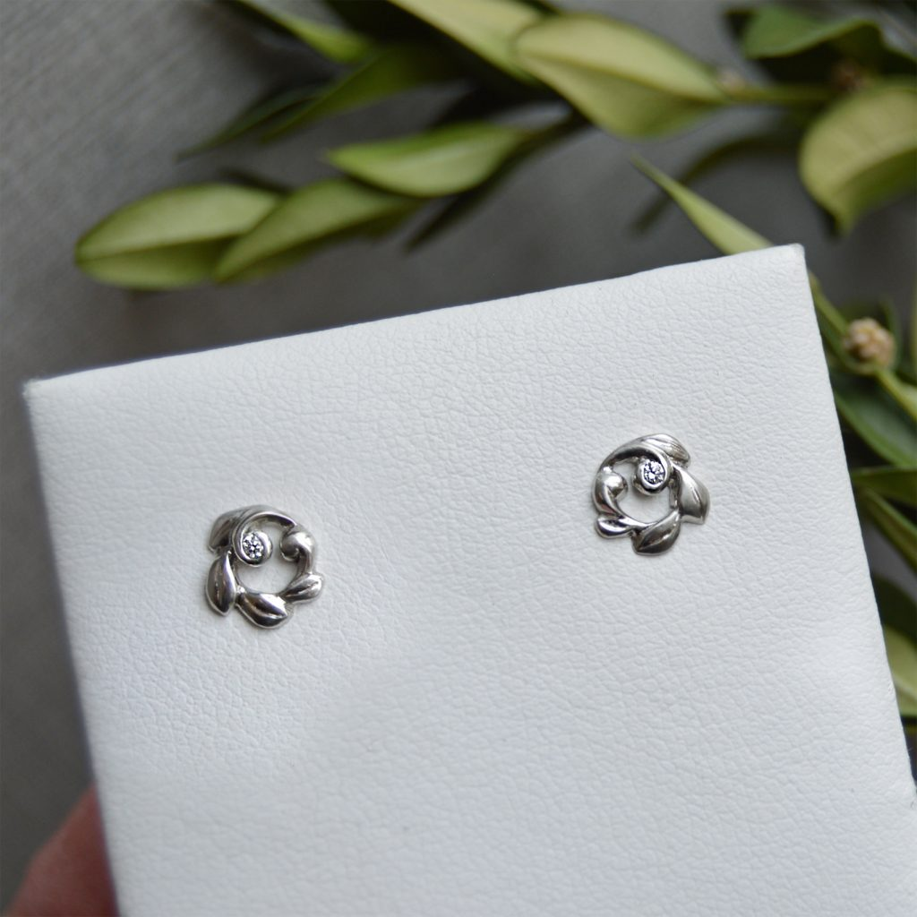 dainty diamond earrings in 14k white gold in leaf vine design with satin finish. Designed by Morgan's Treasure