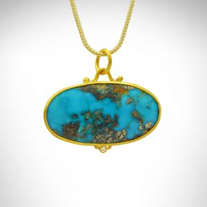 24k yellow gold bezel with sterling silver back turquoise oval horizontal pendant with accent diamond on 14k yellow franco chain