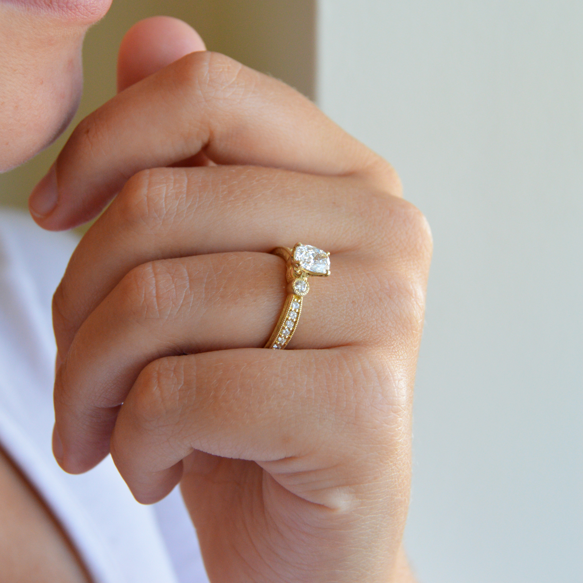 Vintage inspired Shah Carizza ring has a cushion-cut center stone.