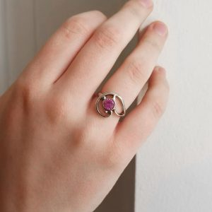 Pink/Magenta round faceted sapphire ring in 14K white gold with swirl design and bezel setting