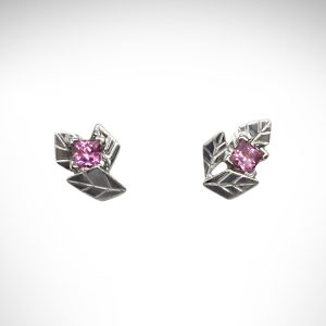 14k white gold stud earrings, carved in the shape of clusters of leaves, set with square-cut pink tourmaline gemstones.