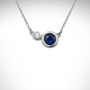 "14K white gold necklace with 2 bezel set gemstones- sapphire and diamond with 18"" cable chain"