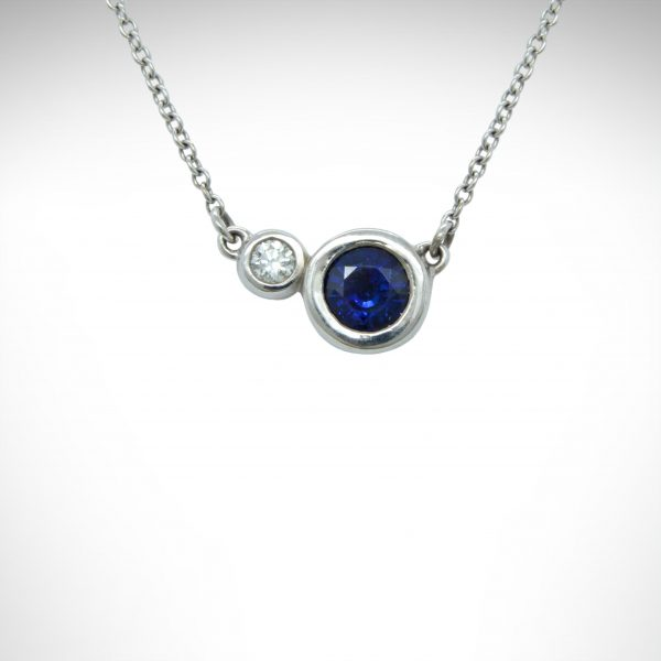 """14K white gold necklace with 2 bezel set gemstones- sapphire and diamond with 18"""" cable chain"""