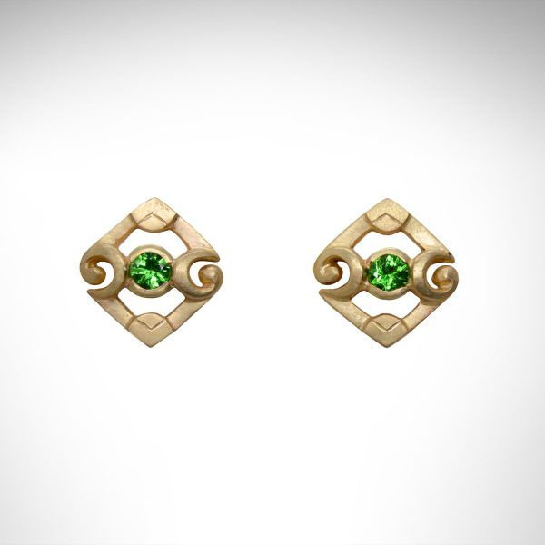 14K yellow gold stud earrings with scrolling art deco design with green tsavorite garnets.